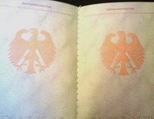 This is how the stamping pages of the passport look like, with the Coat of arms of Germany.
